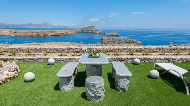 Lindos Vigli Villa - Stone table and chairs in the garden area