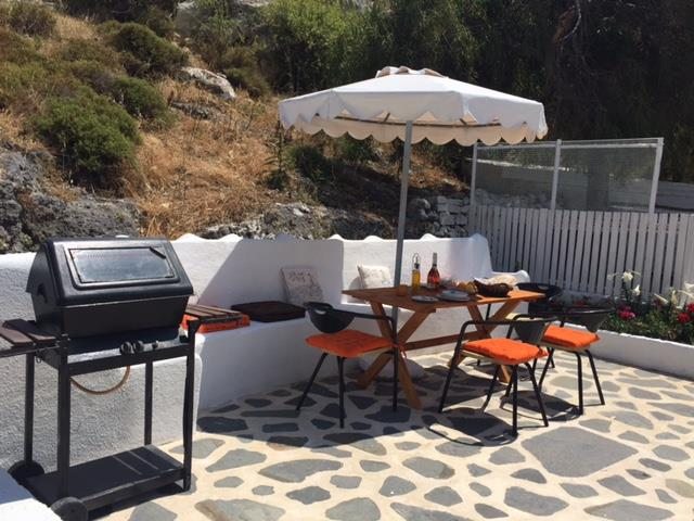 Avli Beachlover - Garden Terrace dining area with BBQ